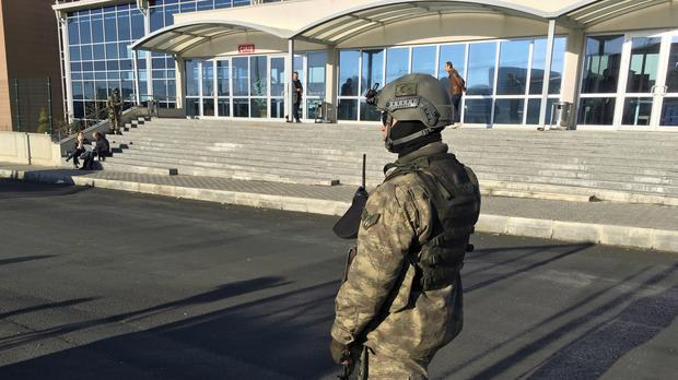 A paramilitary police officer stands at the entrance of Silivri Prison and Courthouse complex where 29 Turkish former police officers are on trial (AP/Mehmet Guzel)