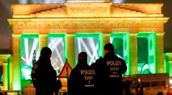 German police men guard the venue at the Brandenburg Gate, during the upcoming New Year's Eve celebrations in Berlin, Germany, December 31, 2016. Photo: REUTERS/Fabrizio Bensch