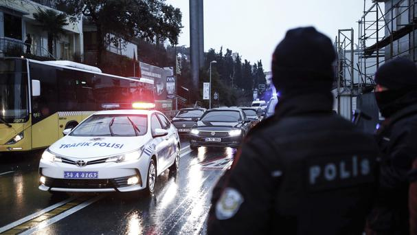 Police officers at the scene of the attack in Istanbul (AP)