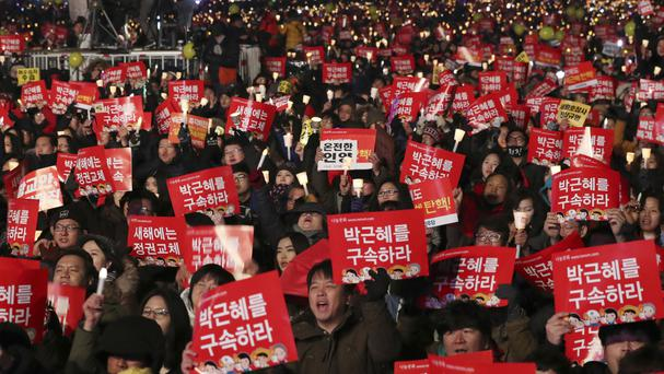 Protesters demand the resignation of South Korean President Park Geun-hye in Seoul (AP)