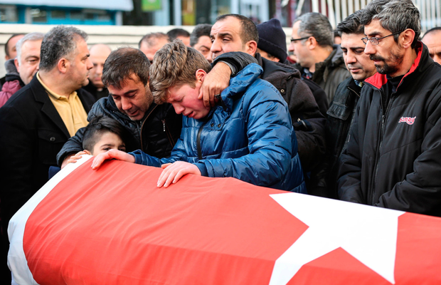 Relatives and friends mourn at a coffin during the funeral yesterday of Ayhan Arik, one of the 39 victims of the gun attack in the Reina Photo: Burak Kara/Getty Images