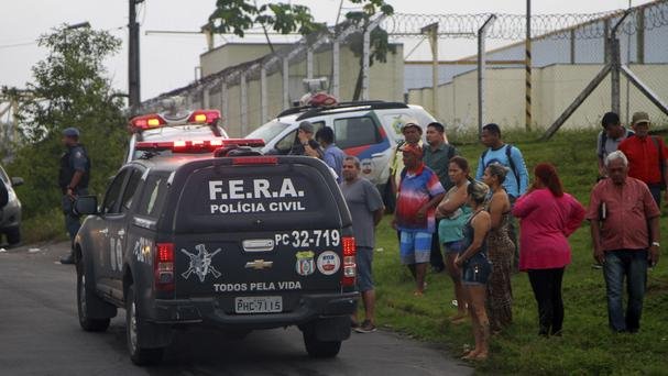 Relatives of prisoners wait for information outside the Anisio Jobim Penitentiary Complex in Manaus (Futura Press/AP)