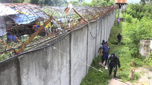Policemen patrol outside the walls of the North Cotabato District Jail after a massive jailbreak (AP Photo)