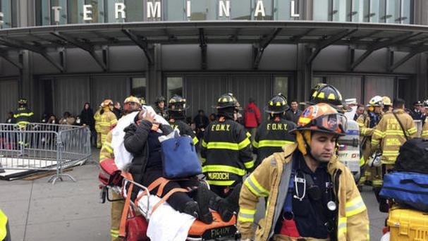 An injured passenger is taken from the Atlantic Terminal in the Brooklyn borough of New York (AP/Mark Lennihan)