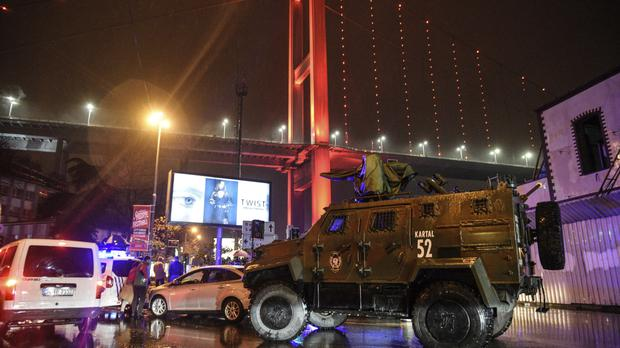 A police armoured vehicle blocks the road leading to the scene of the attack on a nightclub in Istanbul (AP)