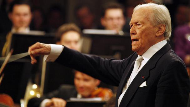 Georges Pretre, who has died aged 92, conducting the Vienna Philharmonic Orchestra in 2010 (AP)
