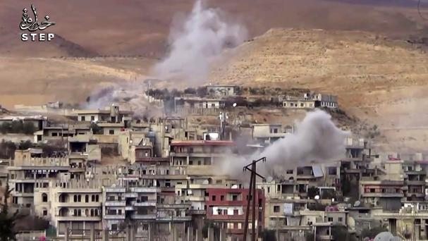 Government forces shelling Wadi Barada, north west of Damascus (Step News Agency/AP)