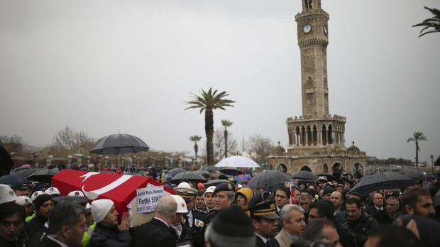 Police carry the coffin of officer Fethi Sekin, who was killed in a car bombing in Izmir (AP)