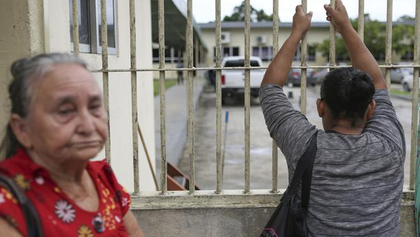 Relatives of prisoners wait to learn the names of inmates who died in a prison riot in Manaus (AP)