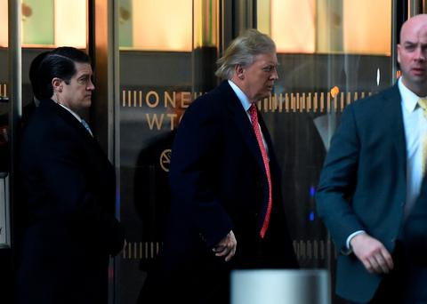 President-elect Donald Trump leaves One World Trade Centre in New York after a meeting with editors at Condé Nast yesterday Photo: Timothy Clary/AFP