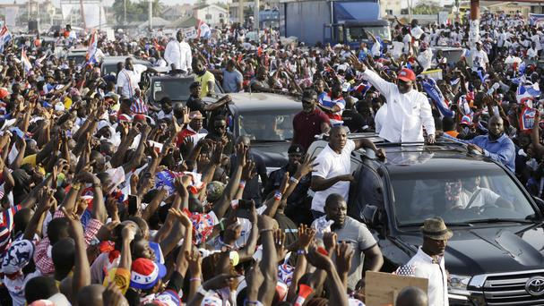 Nana Akufo-Addo waves to his supporters during a presidential election rally in Accra. AP