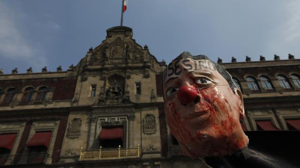 Protesters demonstrate with an effigy of President Enrique Pena Nieto, against fuel price rises, outside the national palace in Mexico City (AP/Marco Ugarte)