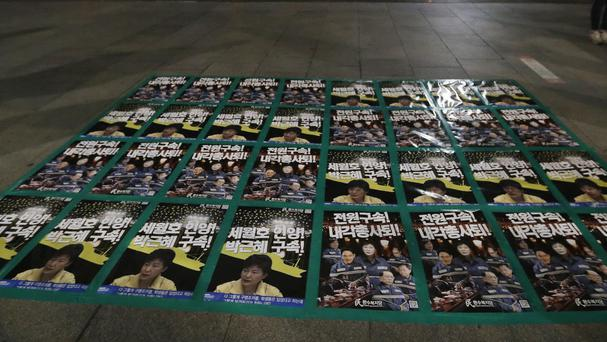 Posters showing portraits of impeached President Park Geun-hye her aides and business men close to her are displayed during a vigil in Seoul (AP/Ahn Young-joon)
