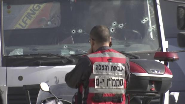 Israeli emergency services personnel at scene of a truck-ramming attack in Jerusalem that killed at least four people. (AP)