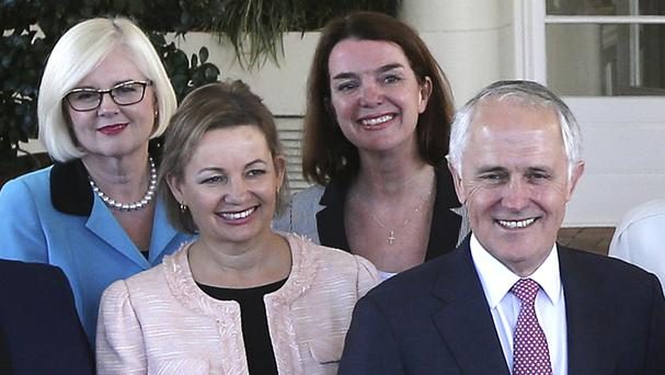 Sussan Ley, to the left of Malcolm Turnbull - the health minister has stood aside while her travel expenses are investigated (AP Photo/Rob Griffith)