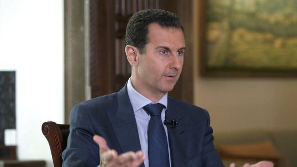 Syrian President Bashar Assad says the bombing of Aleppo was justified. (AP)