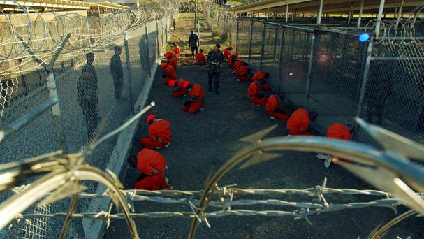 Detainees in orange jumpsuits at Guantanamo Bay, Cuba