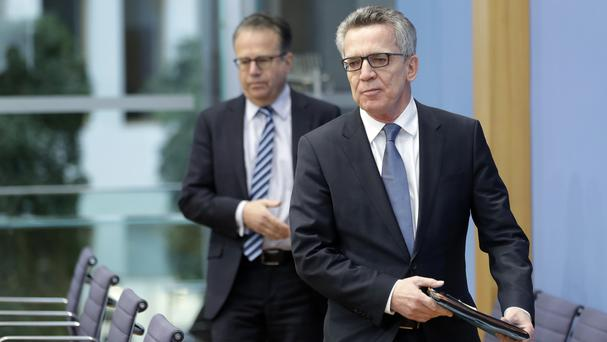 German Interior Minister Thomas de Maiziere, right, and Frank-Juergen Weise, head of the Federal Office for Migration and Refugees. (AP/Michael Sohn)