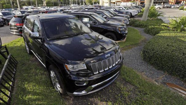 Jeep Grand Cherokees on display at a Fiat Chrysler dealership in Doral, Florida (Alan Diaz/AP)