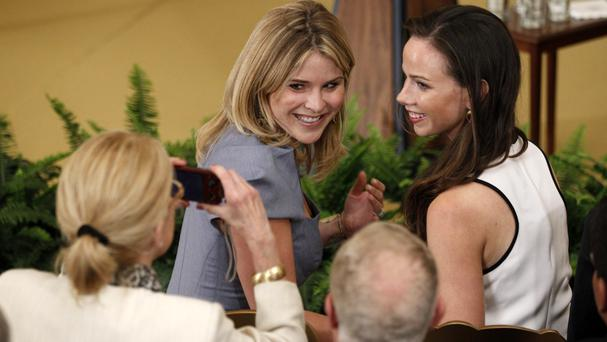 Former president George W Bush's daughters Jenna and Barbara have their photo taken at the White House in 2012 (Charles Dharapak/AP)