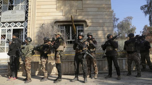 Iraqi special forces advance inside Mosul University during fighting against Islamic State militants in the eastern side of Mosul, Iraq (AP Photo/ Khalid Mohammed)