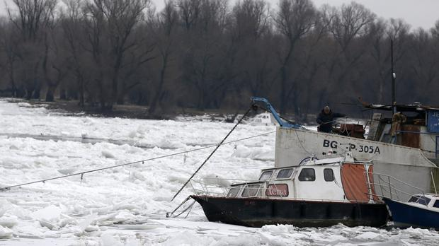 A boat is trapped by ice on the Danube (AP)