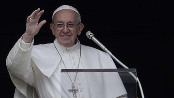 Pope Francis waves to the faithful during the noon prayer he delivered overlooking St Peter's Square (AP Photo/Andrew Medichini)