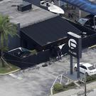 Law enforcement officials work at the Pulse nightclub in Orlando following the mass shooting (AP)
