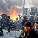 Iraqi special forces react after a car bomb explodes during an operation to clear the al-Andalus district of Isil militants in Mosul.