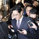 Lee Jae-yong is questioned by reporters upon his arrival at the Seoul Central District Court in Seoul (AP/Lee Jin-man)