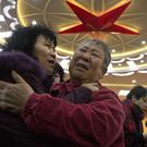 Relatives of passengers on board the missing Malaysia Airlines Flight 370, comfort each other before a meeting with officials in Beijing (AP/Ng Han Guan)