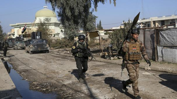 Iraqi special forces troops advance during a battle against Islamic State militants in eastern Mosul (AP/ Khalid Mohammed)