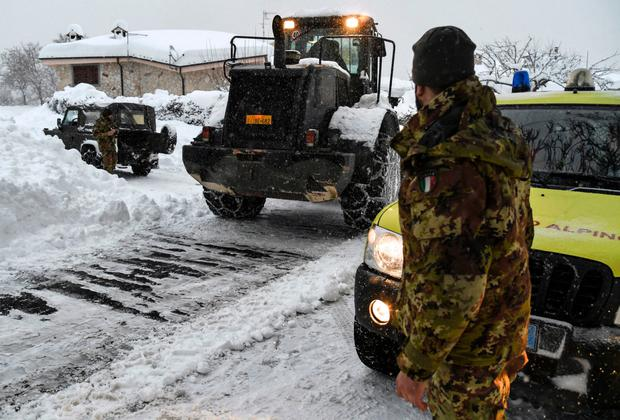 An Italian soldier stands by an emergency vehicle in Aringo near Montereale, Italy, after the earthquakes. Photo: Getty