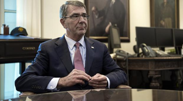 Ash Carter in his Pentagon office, as he said he had opposed commuting the prison sentence of convicted leaker Chelsea Manning (AP/Cliff Owen)