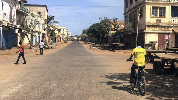 Few venture into the streets as shops remain closed in Banjul, Gambia (AP)