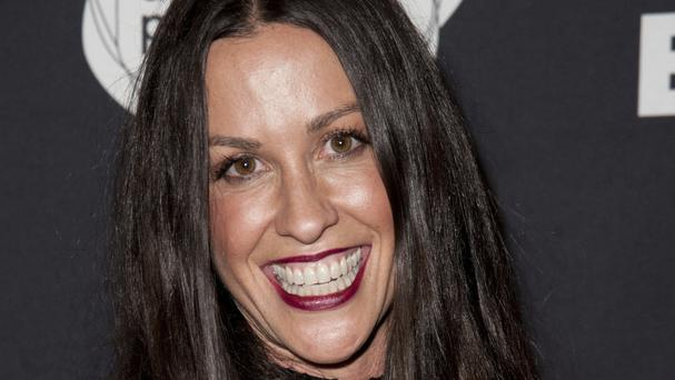 Alanis Morissette pictured in 2014 in Santa Monica, California, as a former manager agreed to plead guilty to embezzling millions of pounds from her (Richard Shotwell/Invision/AP,File)
