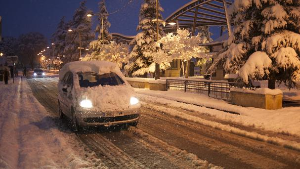 A man drives his car through a street covered with snow in Ronda, southern Spain (AP/Javier Gonzalez)