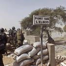 Cameroon soldiers stand guard at a lookout post as they take part in operations against Boko Haram near Nigeria's Borno state, where a refugee camp was mistakenly bombed (AP/Edwin Kindzeka Moki)