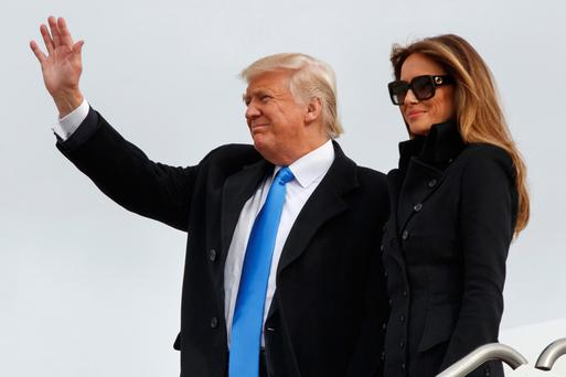 US President-elect Donald Trump and his wife Melania Trump arrive aboard a US Air Force jet at Joint Base Andrews, Maryland, yesterday. Photo: Reuters