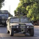 Senegalese troops moving towards the Gambia border (AP/Sylvain Cherkaoui)