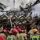 Iranian firefighters remove debris from the Plasco building in central Tehran (AP)