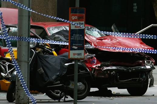 The wreckage of a car is seen as police cordoned off Bourke Street Mall, after a car hit pedestrians in central Melbourne. Photo: Edgar Su/Reuters
