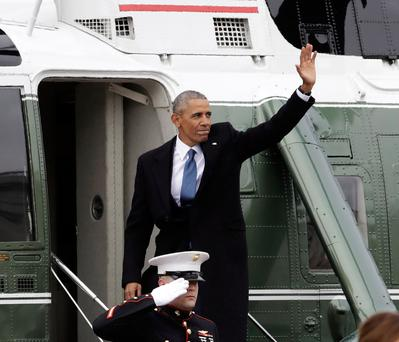 Outgoing president Barack Obama waves as he departs from Capitol Hill Picture: AP
