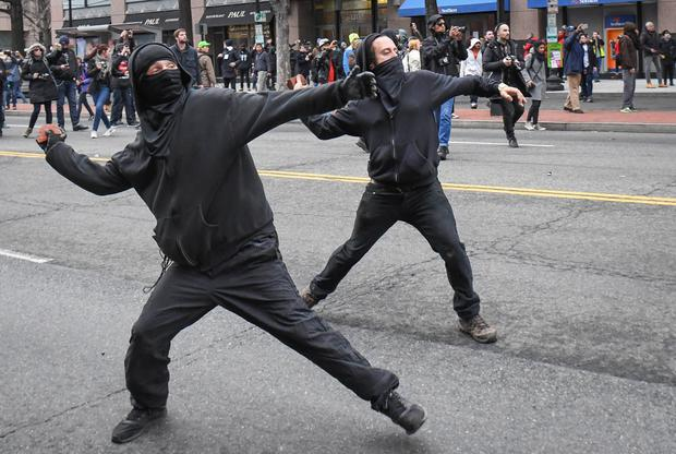 Protesters throw missiles at police during street clashes in Washington Picture: