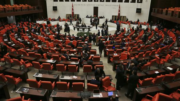 Turkey's parliament debates changes to the constitution that would hand President Recep Tayyip Erdogan sweeping executive powers (AP Photo/Burhan Ozbilici)