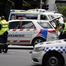 Police and rescue vehicles at the scene after a car struck pedestrians in the central business district of Melbourne (AP Photo/Andrew Brownbill)
