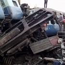 In this image from video, rescuers at the scene of a derailed passenger train in southern India (KK Production/AP)