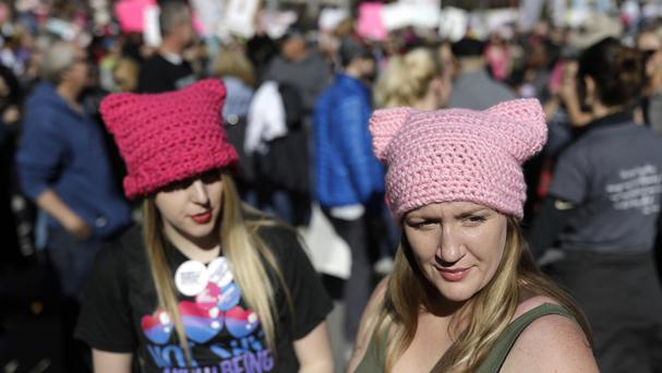People wear pink hats while protesting against President Donald Trump during the Women's March in Las Vegas (AP Photo/John Locher)