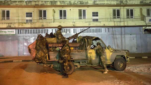 Senegalese troops outside the state house in the Gambian capital Banjul (AP Photo/Jerome Delay)