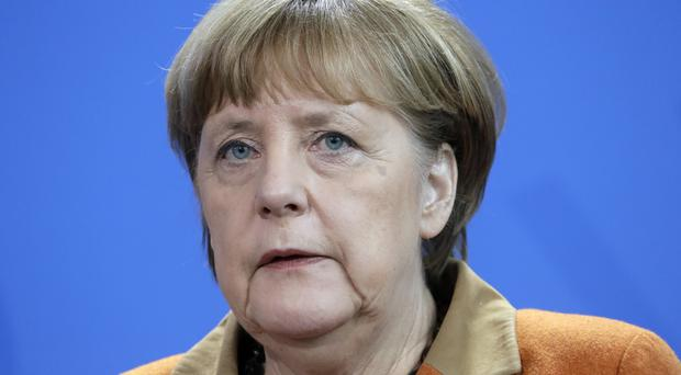 Mrs Merkel is seeking a fourth term as chancellor (AP)